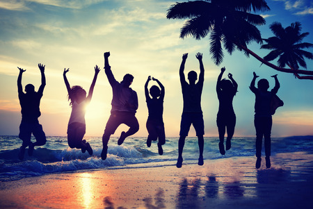 Young People Jumping with Excitement on a Beach photo
