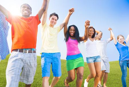 Multi-Ethnic Teenagers Outdoors Holding Hands Celebrating photo