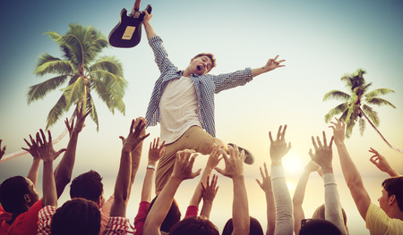 Young Man with a Guitar Performing on a Beach Concert Stock Photo - 29558820