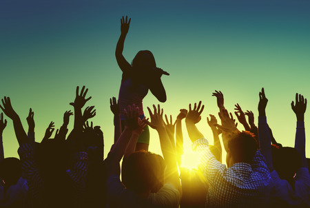 outdoor event: Silhouettes of People at Outdoors Music Festival Stock Photo