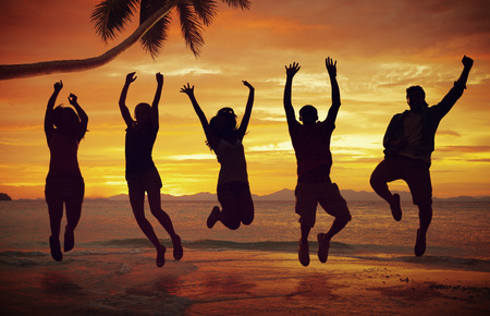 Young People Jumping with Excitement on the Beach photo