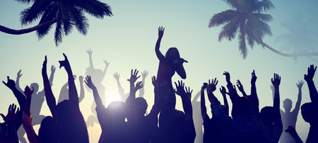 Silhouettes of Young People on a Beach Concert photo