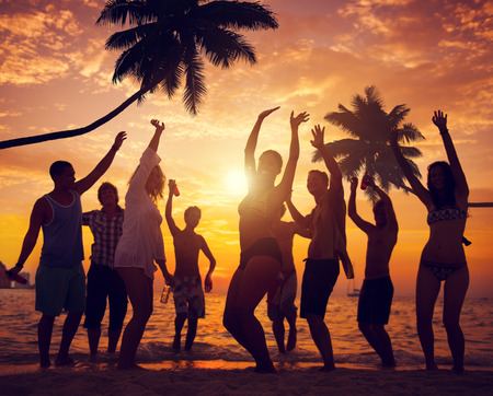 party silhouettes: Diverse People Dancing and Partying on a Tropical Beach Stock Photo