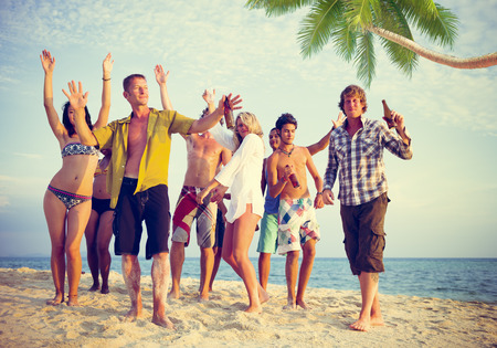 Group of Casual People Partying on a Beach Archivio Fotografico