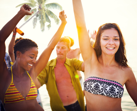 Group of People Partying on a Tropical Beach Stock Photo