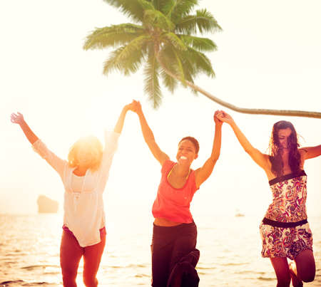 Cheerful Young Women Celebrating by the Beach photo