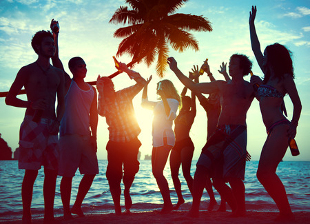 summer festival: Silhouettes of Diverse Multiethnic People Partying Stock Photo