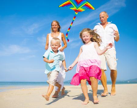 Family running on the beach  photo