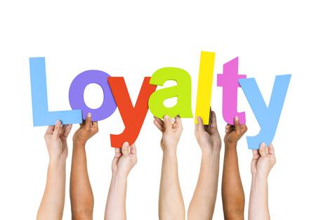 Multi Ethnic People Holding The Word Loyalty Stock Photo
