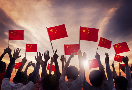 Group of People Holding National Flags of China  photo