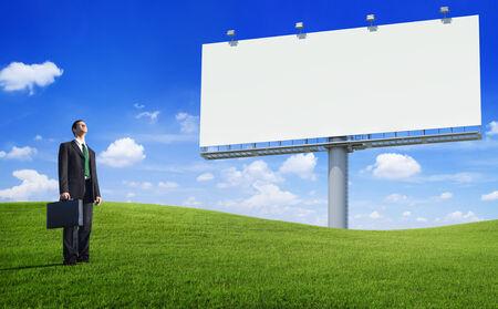 Green Concept Business Man and an Empty Bilboard Zdjęcie Seryjne