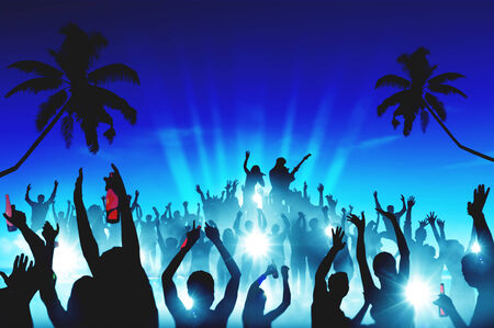 Silhouettes of People at Outdoors Music Festival Stock Photo