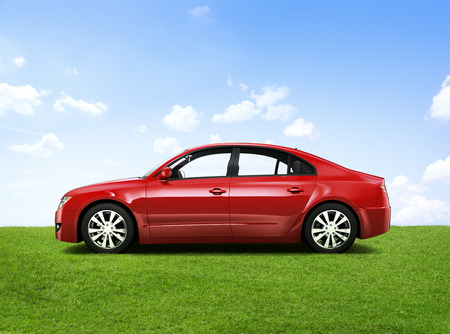 car tire: Shiny red sedan in the outdoors.