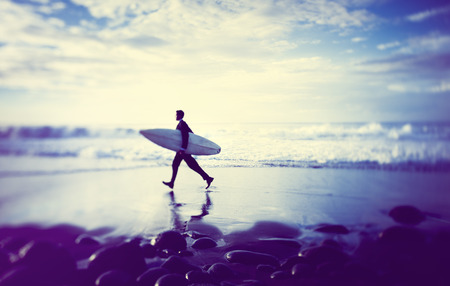 Lone Businessman by the Beach with Surfboard photo