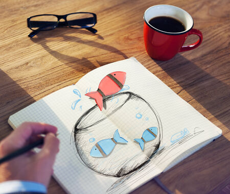 fishes: Man Drawing Fishes on a Fish bowl Stock Photo