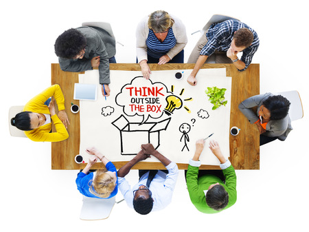 People in a Meeting and Thinking Outside the Box Sayings photo