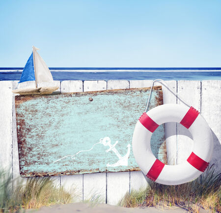 water anchor: Empty Sign Board and Wooden Fence on Beach Stock Photo