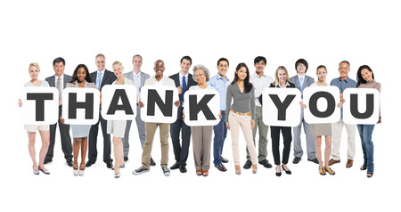 Multi-Ethnic Group Of Diverse People Holding Letters That Form Thank You Stock Photo