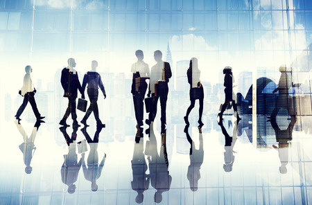 BUSY OFFICE: Silhouettes of Business People Walking inside the Office