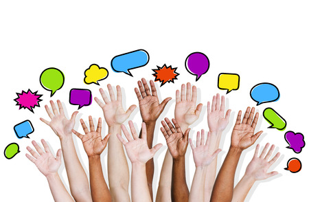 Group of human arms raised with speech bubble  photo