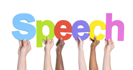 dialects: Diverse Hands Holding the Word Speech Stock Photo