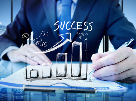 performance improvement: Businessman in a Office and Success Chart Stock Photo