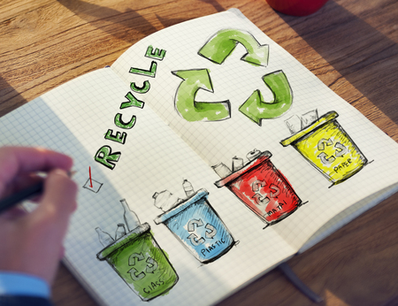 Man with a Notepad with Recycling Concept