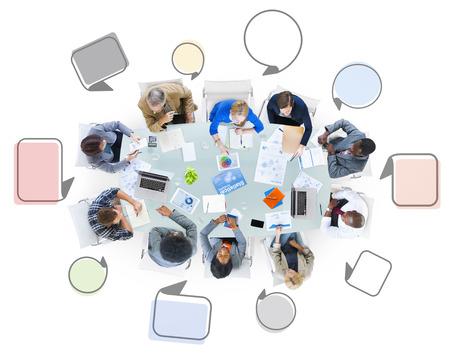 スピーチの泡とビジネスミーティングの人々 のグループ 写真素材