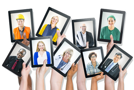 Group of Hands Holding Tablets with People photo