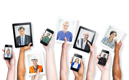 Hands Holding Digital Devices with Professional People photo