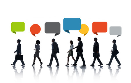 Multiethnic Business People Walking in a Row with Speech Bubble photo