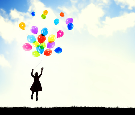 Little Girl in the Air Holding Balloons