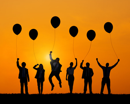 away from it all: Business People Jumping While Holding Balloons