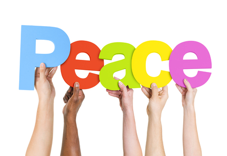nonviolence: Multi-Ethnic Group Of People Holding The Word Idea Stock Photo