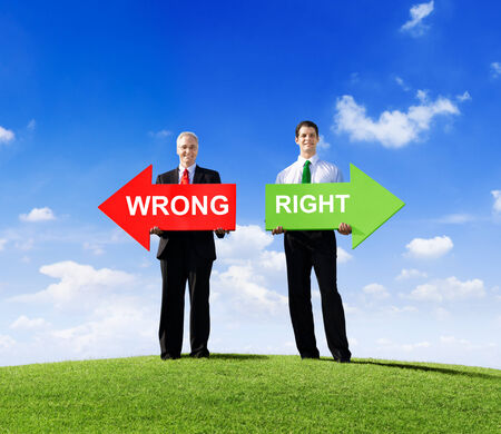 Two Businessmen Holding Contrasting Arrows for Wrong and Right Stock Photo