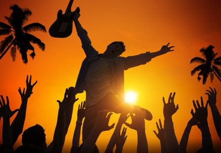 Silhouettes of People in Music Festival by the Beach