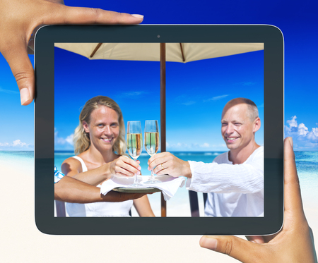 Picture of Woman and Man Having Champagne by the Beach photo