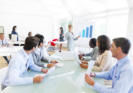 Business Presentation of a Corporate Woman to her Colleagues Stock Photo