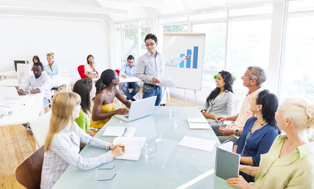Group of Business People Planning and Listening to the Dicussion of their Colleague Stock Photo