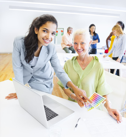 designer: A Designer Choosing a Color from the Color Swatch Stock Photo