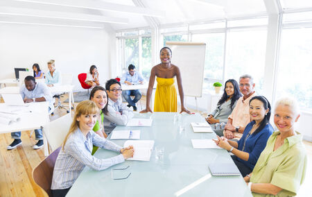 Group Cheerful Business People in an Office Building  Stock Photo