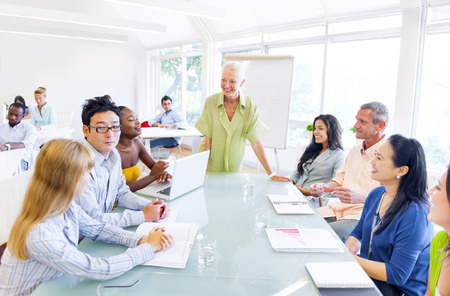 Group of Business People having a meeting in their Office photo