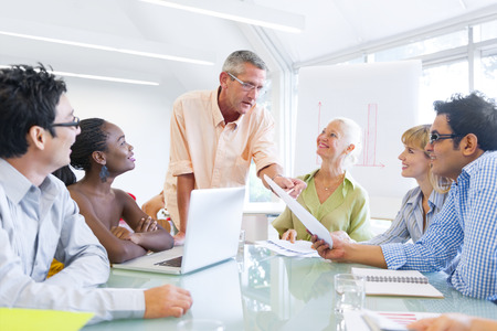 training workshop: Group of Business People Learning With the Help of Their Mentor Stock Photo