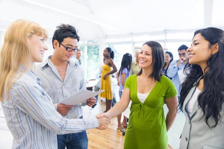 Two Smart-Casual Women Having a Handshake