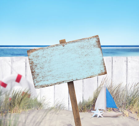 wood fence: Empty Sign Board and Wooden Fence on Beach Stock Photo