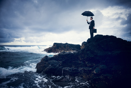 Lonely Businessman Standing by the Beach Stock Photo