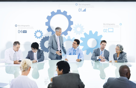 Business People in a Meeting and Gear Symbols photo