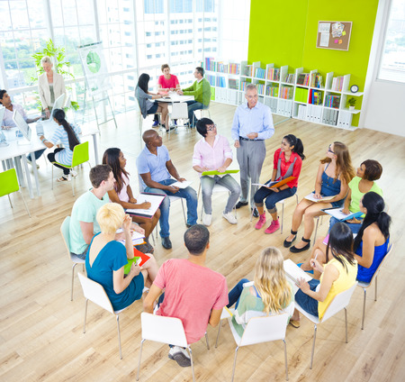team meeting: Group of Student in the Classroom Stock Photo