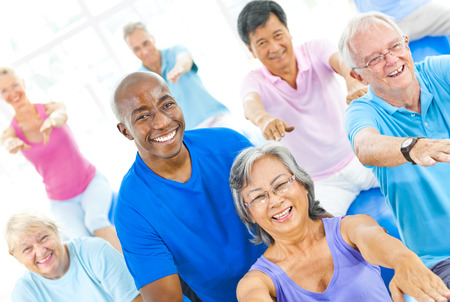 senior woman exercising: Group of Healthy People in the Fitness