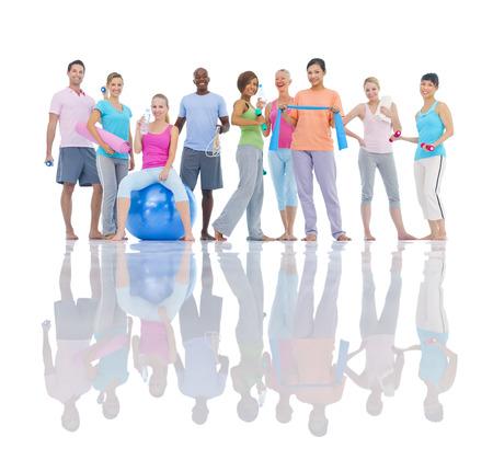 gente saludable: Grupo de personas sanas en el gimnasio